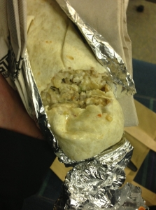 A burrito, as eaten by a man who has no idea how to eat a burrito